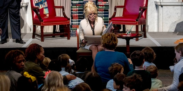 """Dolly Parton read her book """"Coat of Many Colors"""" to the audience."""