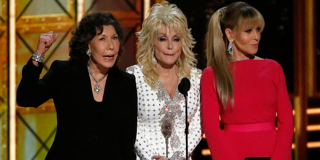 Dolly Parton (center) remained tight lipped when Lily Tomlin (left) and Jane Fonda (right) cracked a Trump joke at the 2017 Emmys.