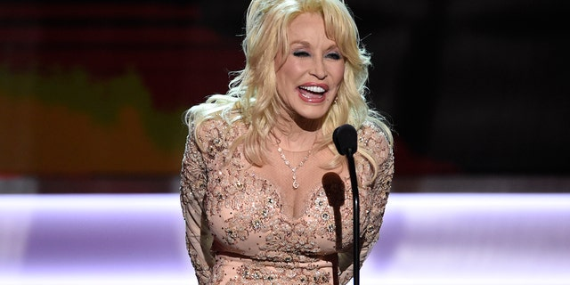 In this Jan. 29, 2017, file photo, Dolly Parton presents the Lifetime Achievement Award at the 23rd annual Screen Actors Guild Awards at the Shrine Auditorium & Expo Hall in Los Angeles. Five people have been charged in Tennessee with conspiring to defraud the My People Fund of Dolly Parton's Dollywood Foundation, set up to help people affected by wildfires last year.