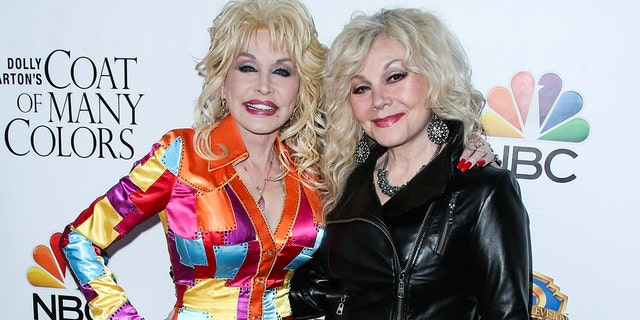 """Dolly Parton (left) and Stella Parton attend the Los Angeles Premiere Of Warner Bros. Television's """"Dolly Parton's Coat Of Many Colors"""" held at the Egyptian Theatre on December 2, 2015."""