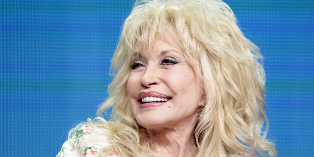 Dolly Parton celebrates Tennessee's reopening amid pandemic at Dollywood, performs 'Coat of Many Colors'.jpg