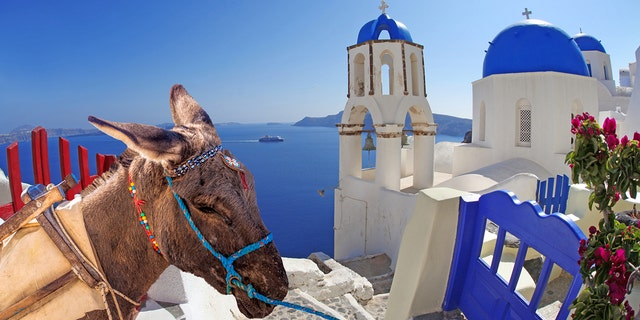 Over 1,000 tourists a day flood Santorini during the peak vacation season between May and October.