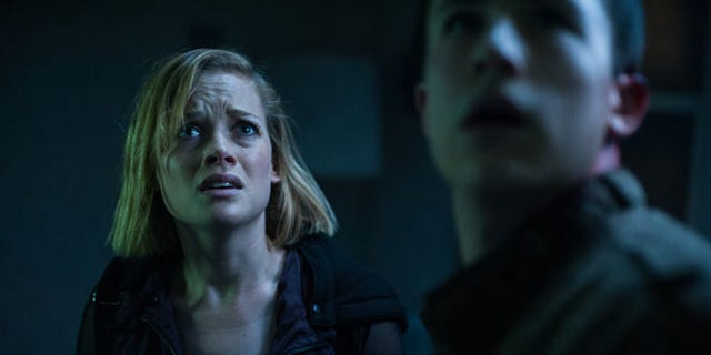 """FILE - This undated file image released by Sony Pictures shows Jane Levy, left, and Dylan Minnette in a scene from """"Dont Breathe."""" According to studio estimates Sunday, Aug. 28, 2016, audiences turned out in droves for the late summer thriller, which brought in $26.1 million. (Gordon Timpen/Sony/Screen Gems via AP, File)"""