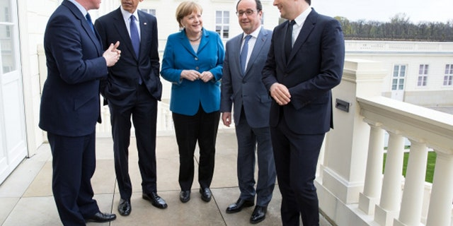 From left to right: This picture shows then-UK Prime Minister David Cameron, President Obama, German Chancellor Angela Merkel, French President Francois Hollande and Italian Prime Minister Matteo Renzi  at the G5 summit in April in Hannover, Germany