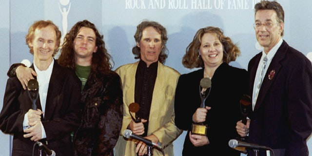 Members of The Doors pose after being inducted in the Rock 'n' Roll Hall of Fame. From left are guitarist Robby Krieger, Pearl Jam's Eddie Vedder (who presented the award), drummer John Densmore, Anne Cheuring (sister of the late Jim Morrison) and keyboardist Ray Manzarek.