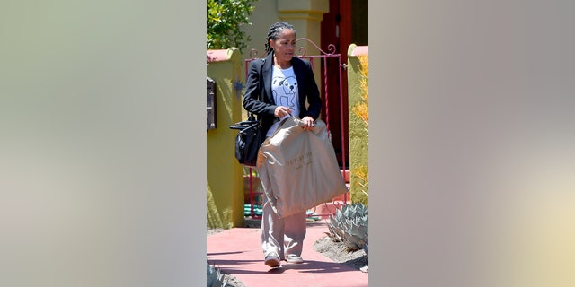 Doria Ragland spotted leaving for the airport in Los Angeles for the royal wedding.