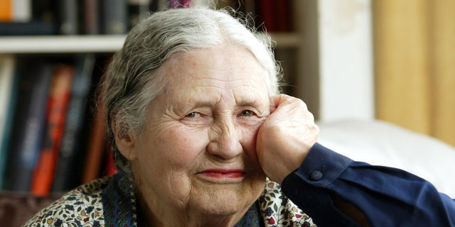 "In this April 17, 2006 file photo, Writer Doris Lessing, 86, sits in her home in north London. Lessing, the free-thinking, world-traveling, often-polarizing writer of ""The Golden Notebook"" and dozens of other novels that reflected her own improbable journey across the former British empire, has died, early Sunday, Nov. 17, 2013. She was 94."