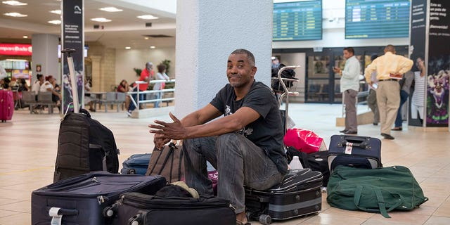 Displaced passengers are reportedly sleeping in the airport due to the high prices of nearby lodging.
