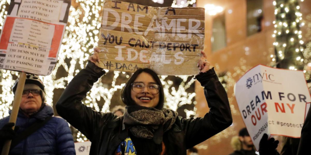 DACA participant Gloria Mendoza and others demonstrate in support of the program, in New York City, Jan. 10, 2018.