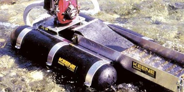 The technique involves sucking up sediment from the bed of the creek or river, sifting out gold and spitting the rest back into the water. (Courtesy: American Mining Rights Association)