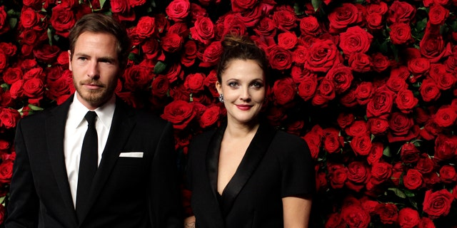 Actress Drew Barrymore (R) and Will Kopelman (L) attend the Museum of Modern Art's fourth annual Film Benefit in New York November 15, 2011. REUTERS/Kena Betancur (UNITED STATES - Tags: ENTERTAINMENT) - RTR2U2P7