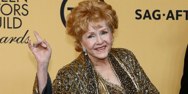 Actress Debbie Reynolds poses backstage after accepting her Lifetime Achievement awards at the 21st annual Screen Actors Guild Awards in Los Angeles, Calif., on Jan. 25, 2015.