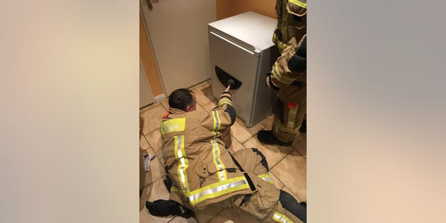 Firefighters were able to crack the code to free a boy who locked himself in the safe.