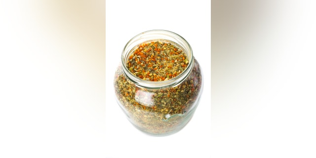 Spices in glass isolated on white