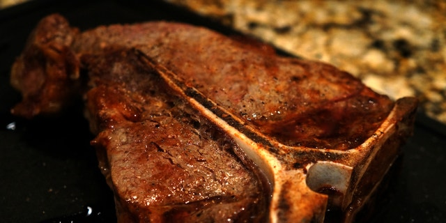 T-Bone Steak is grilled to perfection with mushrooms.