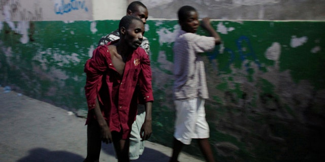 FILE 2010: A Haitian with cholera arrives to receive treatment at St-Catherine hospital in the slum of Cite-Soleil in Port-au-Prince