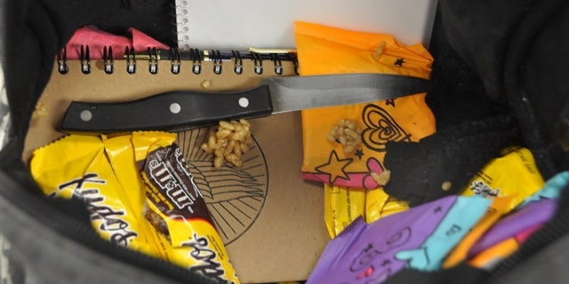 Police found the kitchen knife among a notebook and snack bars inside the girls' backpack.