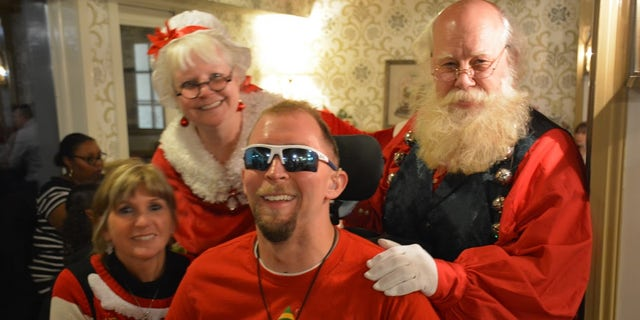 One severely wounded veteran was able to take his photo with Mr. and Mrs. Claus at the Wounded Warrior Project-Pfizer event in Ohio.