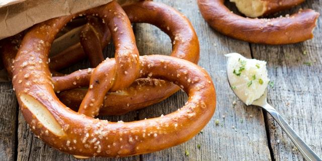 Fresh baked pretzel and cream cheese.Selective focus on the pretzel