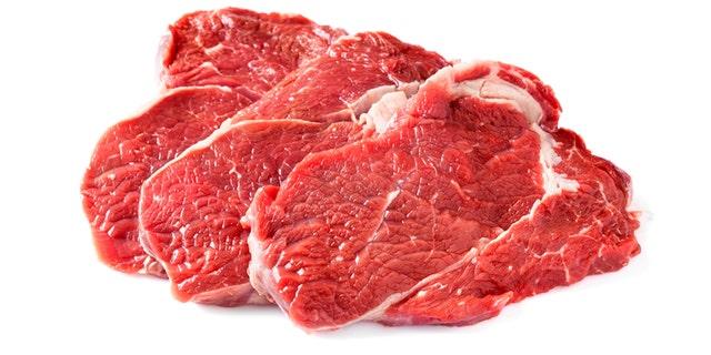 Three chuck steaks on white background