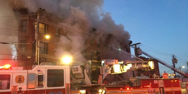 The Fire quickly spread through the four-story building in the Bronx Tuesday morning. At least 12 people were injured.