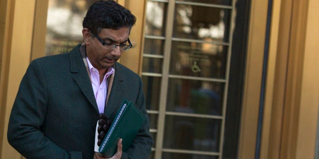 Jan. 24, 2014: Conservative commentator and best-selling author, Dinesh D'Souza exits the Manhattan Federal Courthouse in New York.