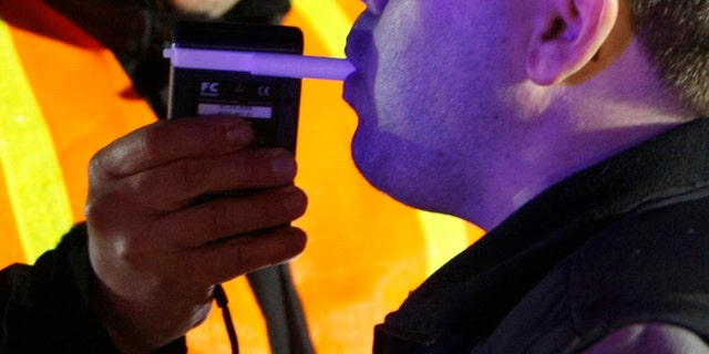 Shown here is a file photo of a driver being tested to see if he is under the influence of drugs or alcohol at a DUI checkpoint.