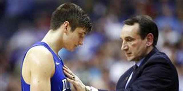 Duke guard Grayson Allen (3) talks with coach Mike Krzyzewski during game against Notre Dame in the Atlantic Coast Conference tournament in Washington on March 10, 2016.