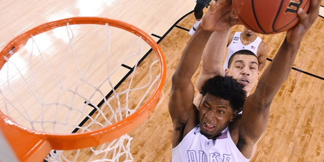 Apr. 4, 2015: Duke's Justise Winslow (12) is fouled by Michigan State's Gavin Schilling, rear, during the second half of the NCAA Final Four tournament college basketball semifinal game. (AP)