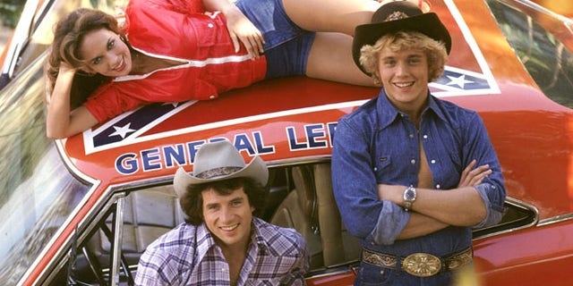 "Catherine ""Daisy"" Bach, Tom ""Luke"" Wopat, John ""Bo"" Schneider and The General Lee."