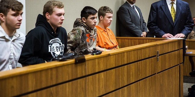 From left to right: Trevor Gray, 15, Alexzander Miller, 15, Mikadyn Payne, 16, and Kyle Anger, 17, appear for their arraignment.
