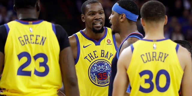 Golden State Warriors' Kevin Durant, center left, argues with Oklahoma City Thunder's Carmelo Anthony, center right, during the first half of an NBA basketball game Saturday, Feb. 24, 2018, in Oakland, Calif.