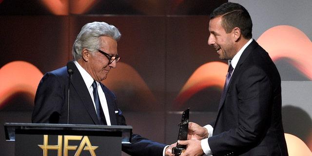 Dustin Hoffman hands an award to Adam Sandler at the Hollywood Film Awards on Nov. 5, 2017.