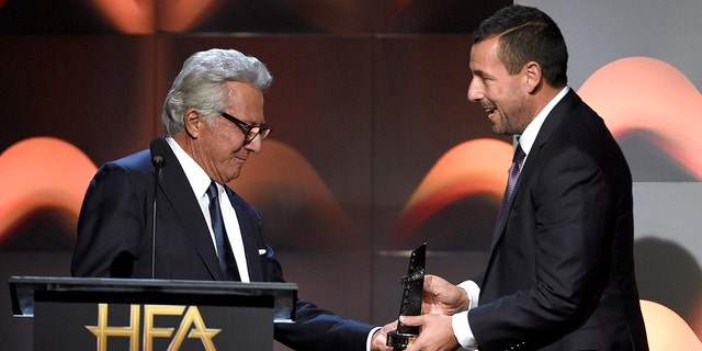 Dustin Hoffman hands an award to Adam Sandler at the Hollywood Film Awards on Nov. 5, 2017.