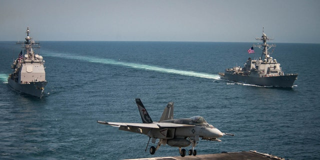 """PACIFIC OCEAN (May 3, 2017) An F/A-18E Super Hornet from the """"Kestrels"""" of Strike Fighter Squadron (VFA) 137 lands on the flight deck of the Nimitz-class aircraft carrier USS Carl Vinson."""