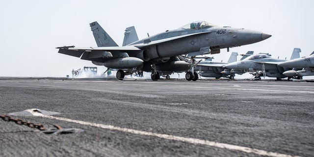 An F/A-18C Hornet landing on the flight deck of the aircraft carrier USS George H.W. Bush in April.