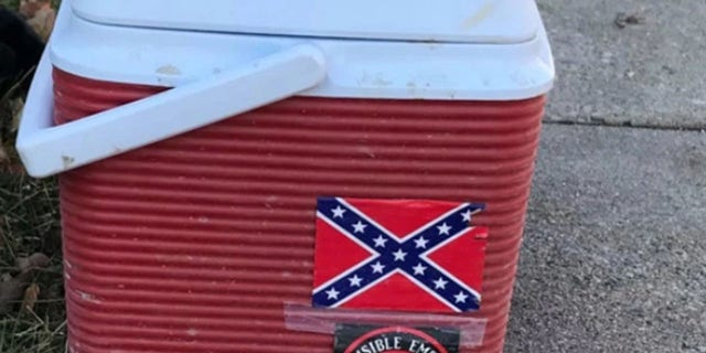 """A worker lost his job after his cooler with """"offensive"""" Ku Klux Klan and Confederate flag stickers was spotted, city officials said."""