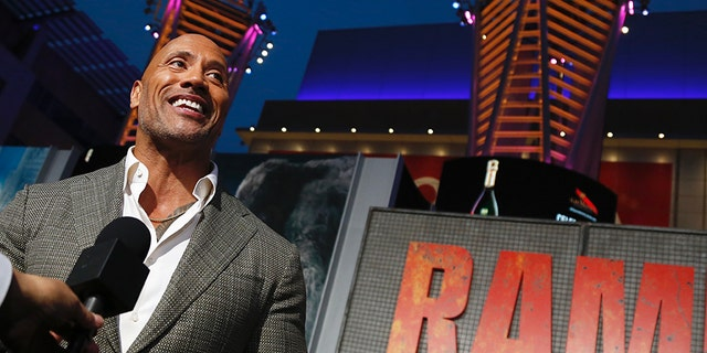 "Dwayne Johnson at the Los Angeles premiere of his film ""Rampage."""