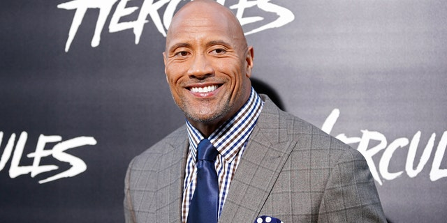 """Cast member Dwayne Johnson poses at the Los Angeles premiere of """"Hercules"""" in Hollywood, California July 23, 2014."""