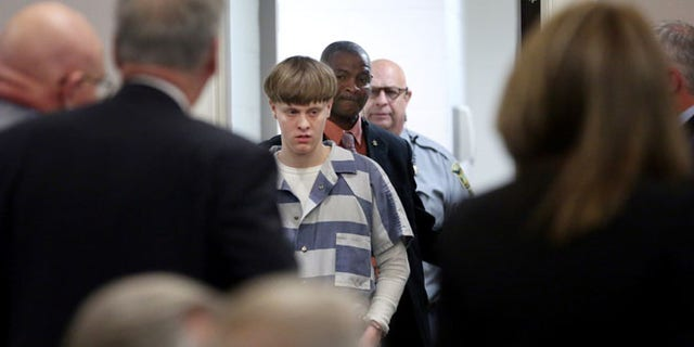 Dylann Roof is escorted into the court room at the Charleston County Judicial Center to enter his guilty plea on murder charges in state court for the 2015 shooting massacre at a historic black church, in Charleston, South Carolina, April 10, 2017. (REUTERS/Grace Beah)