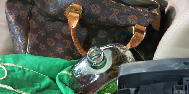 An open bottle of Crown Royal Liquor was found in the passenger seat of Schleicher's car.