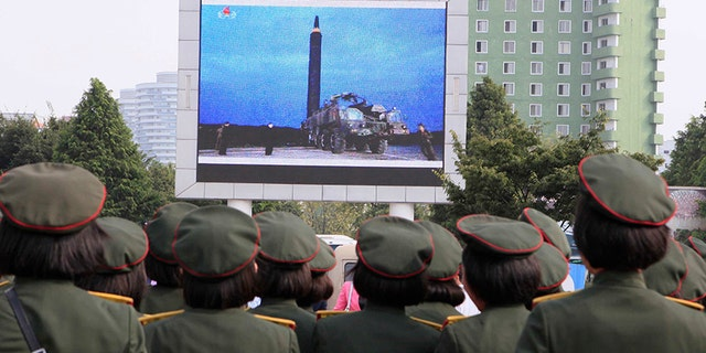 People fill the square of the main railway station to watch a televised news broadcast of the test-fire of an inter-continental ballistic rocket Hwasong-12, Aug. 30, 2017, in Pyongyang, North Korea.