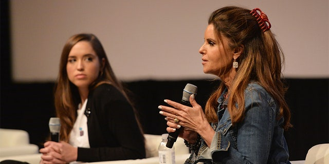 "Maria Shriver (right) speaking about ""Take Your Pills."""
