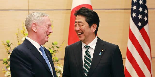 Defense Secretary Jim Mattis, left, with Japanese Prime Minister Shinzo Abe on Friday.