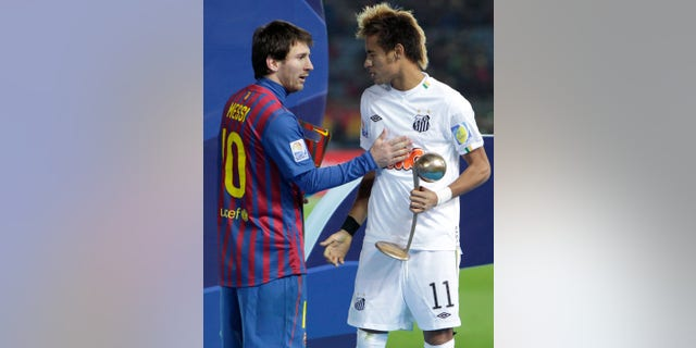 FILE.- In this Dec.18, 2011 file photo, Spain's FC Barcelona midfielder Lionel Messi, left, and Brazil's Santos FC forward Neymar congratulate at each other during an award ceremony at the Club World Cup soccer tournament in Yokohama, near Tokyo, Japan. Neymar announced Saturday May 25, 2013 he has made up his mind and will be joining Barcelona after the upcoming Confederations Cup.(AP Photo/Shizuo Kambayashi, File)