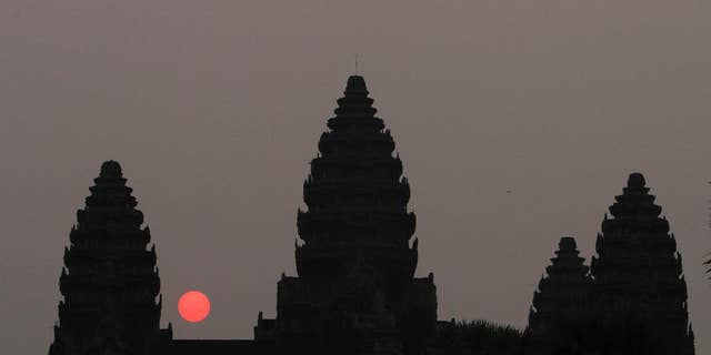 In this Friday, March 20, 2015, file photo, the sun rises behind Angkor Wat at the eastern site of Siem Reap province, some 143 miles northwest of Phnom Penh, Cambodia.