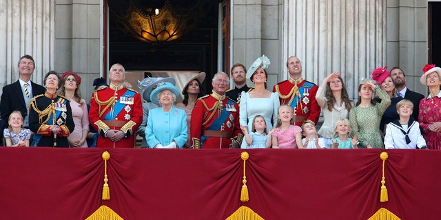 From left, Timothy Laurence, Princess Anne, Princess Beatrice, Prince Andrew, Queen Elizabeth II, Meghan, the Duchess of Sussex, Prince Charles, Prince Harry, Kate, the Duchess of Cambridge and Prince William stand with other members of the Royal family on the balcony of Buckingham Palace, following the Trooping the Colour ceremony at Horse Guards Parade as the Queen celebrates her official birthday, in London.