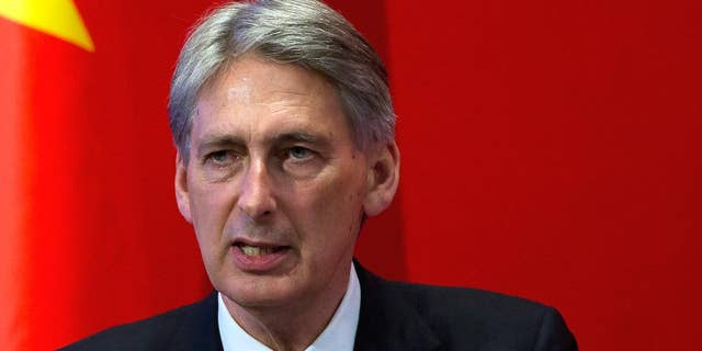 """FILE- In this Aug. 12, 2015, file photo, British Foreign Secretary Philip Hammond delivers his speech at Peking University in Beijing. Hammond confirmed the release of a British hostage, Douglas Robert Semple, by UAE forces in a military intelligence operation on Sunday, Aug. 23. """"The British national is safe and well, and is receiving support from British government officials,"""" said Hammond. (AP Photo/Andy Wong, File)"""