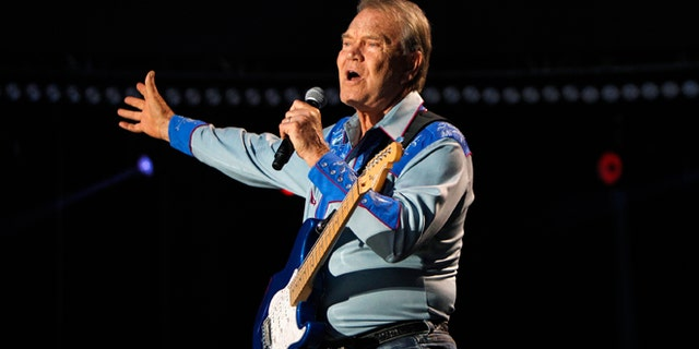 American country music artist Glen Campbell performs during the Country Music Association Music Festival in Nashville, Tenn. circa 2012.