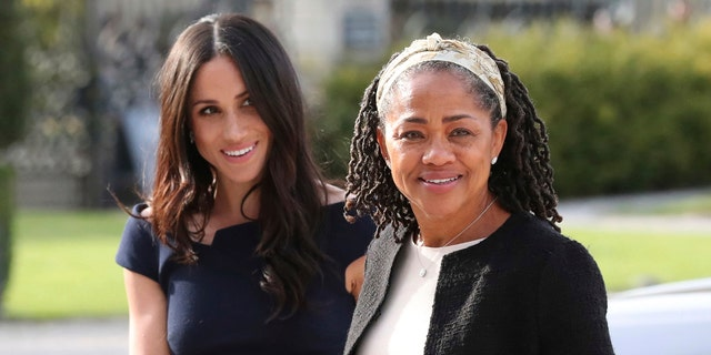 "Meghan Markle, Duchess of Sussex, is seen with her mother, Doria Ragland, ahead of her royal wedding to Prince Harry last May. Ragland has said she is ""overjoyed"" at Duchess Meghan and Prince Harry's royal baby news but a source says she and her daughter aren't that close."